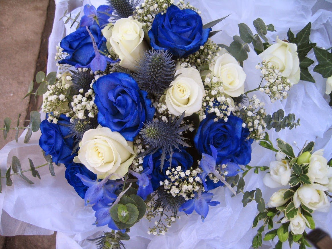 Blue wedding flower arrangements wedding and bridal for Wedding flowers ideas pictures