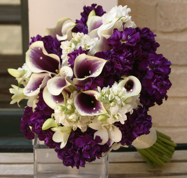 Purple wedding flower arrangements and bridal