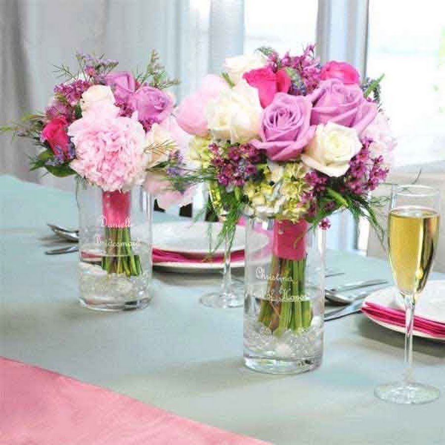 Wedding flower arrangement ideas wedding and bridal for Floral arrangements for wedding reception centerpieces