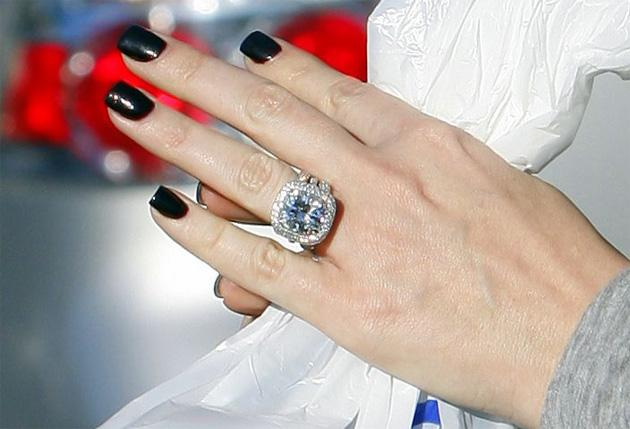Celebrity ring replicas images for Wedding ring tattoos cost