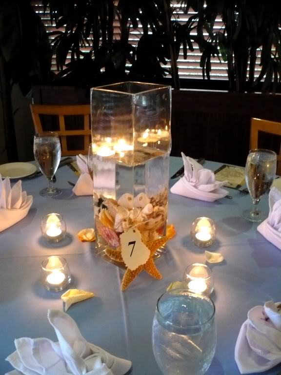 Beach theme centerpieces for wedding tables and