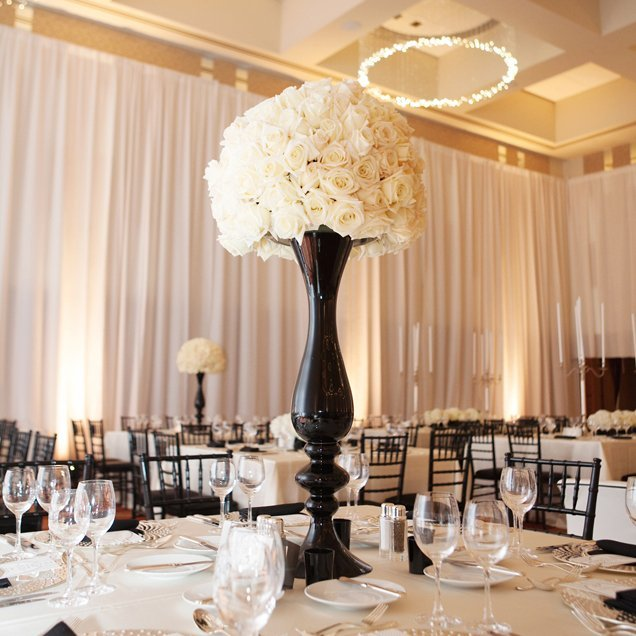 Tall black vases for wedding centerpieces and